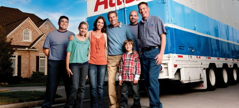 family with movers in front of the truck