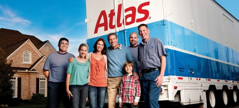 a family and a crew in front of a truck