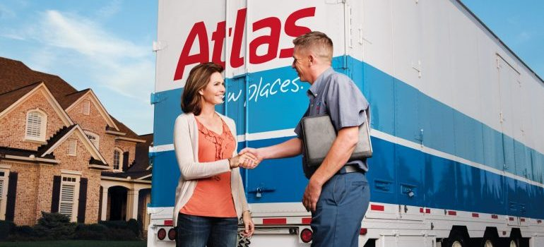 a woman with Alpine NJ movers in front of a truck