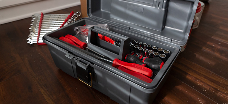 A toolbox with tools inside for disassembling furniture for a move