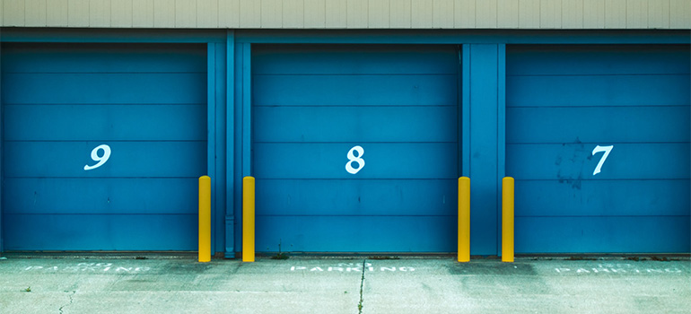 Blue doors of storage units for storing wooden furniture