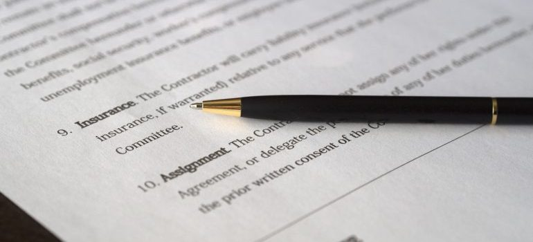 A moving contract and a pen