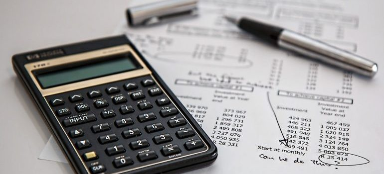 Insurance calculations on paper and a calculator.
