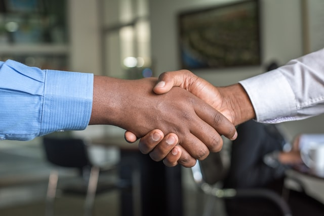 A handshake when hiring movers for your relocation to Montclaire