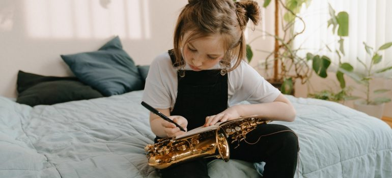 Little girl with a musical instrument.