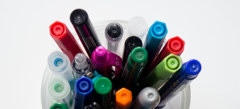 Markers in a cup.