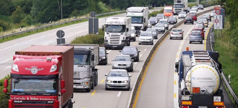 Moving trucks on a highway.