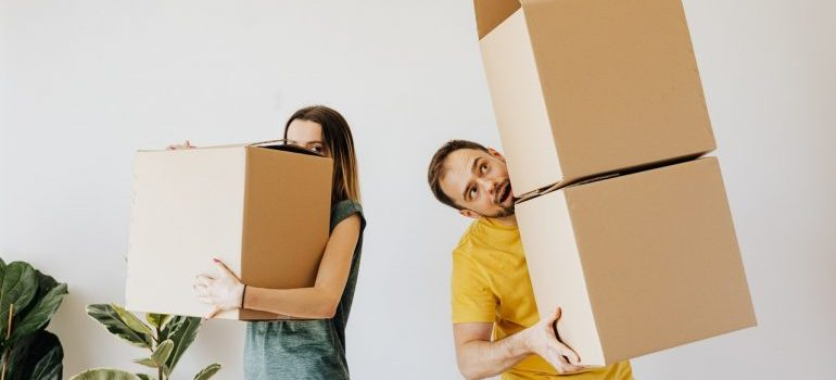A couple with carton boxes.