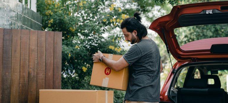 A man loading a moving van.