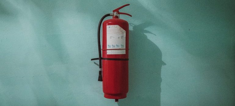 The fire extinguisher you will put up when you childproof your new home after moving.