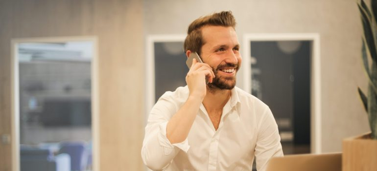 A man talking over the phone in order to get the best deal with NJ movers.