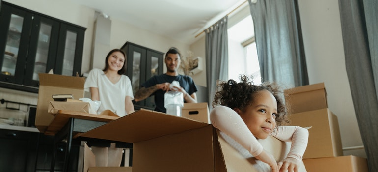 Parents and their daughter packing for moving