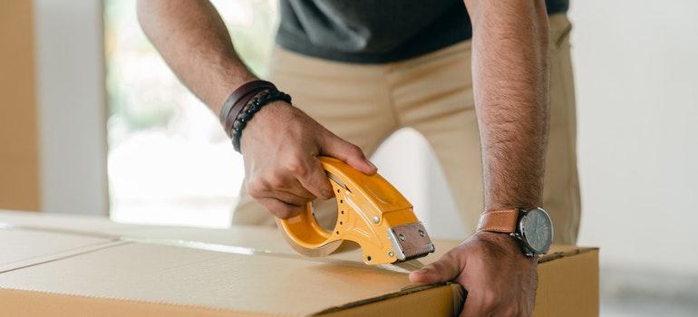 A man packing a box.