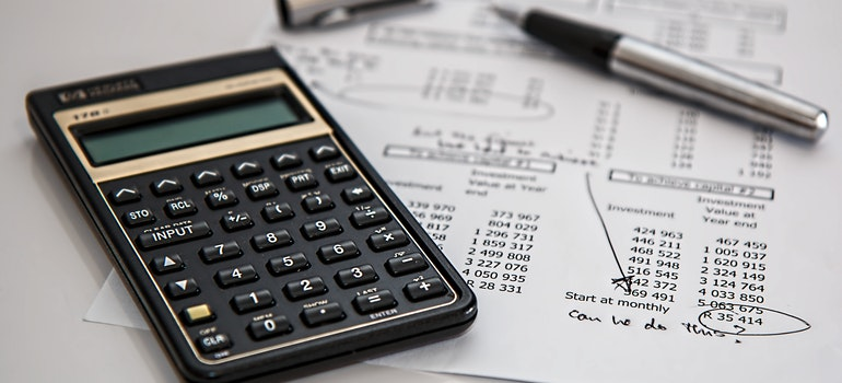 A calculator and papers to calculate your moving expenses.