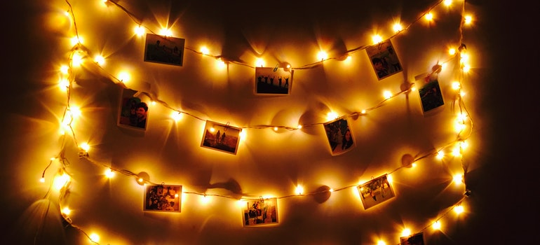 Fairy lights and pictures on a wall.