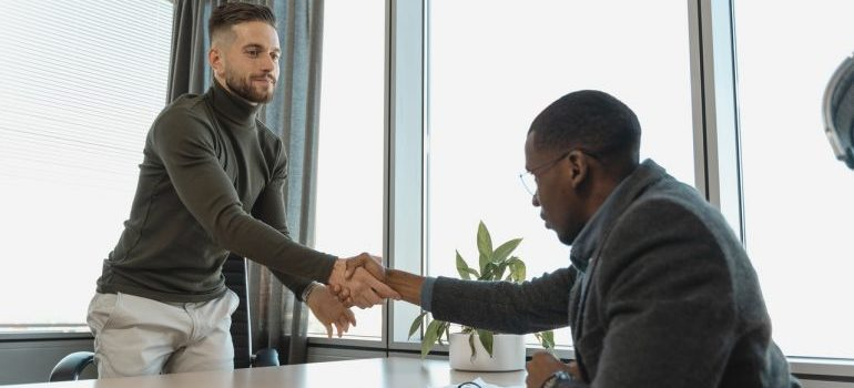 Two man shaking hands in a job interview.