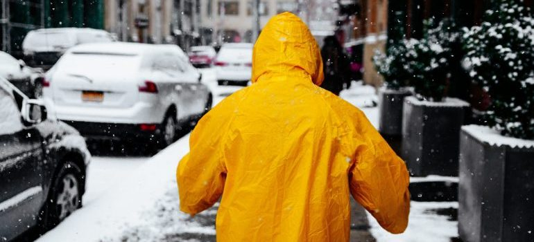 A person in a yellow coat.