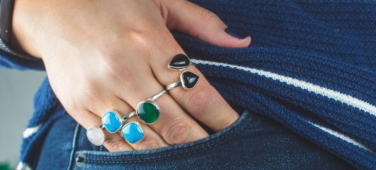rings on a hand in a pocket