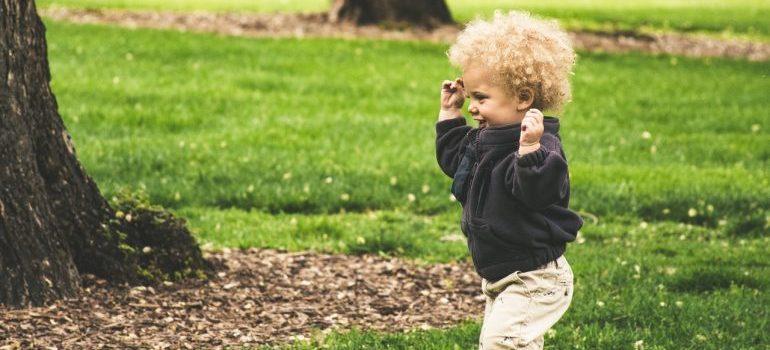 Blonde toddler running excitedly