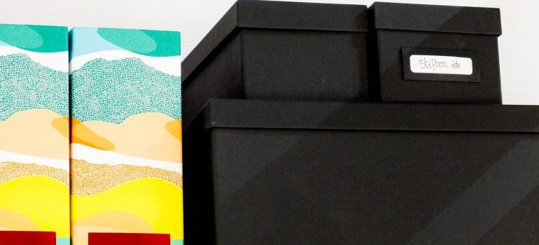 Black and colorful boxes stacked.