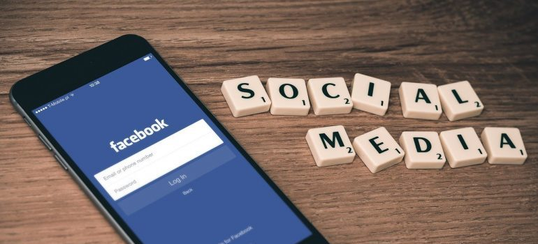 a phone and social media words