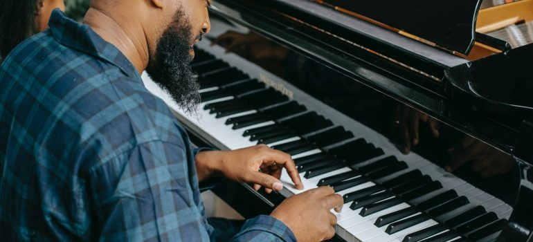 A man in a shirt playing a piano