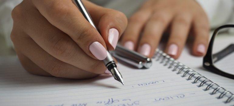 a woman writing down a plan