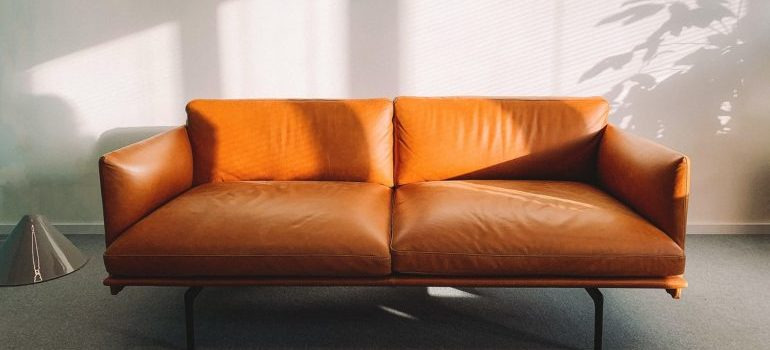 measures of a sofa like this one is what you should include in your pre-move measuring checklist