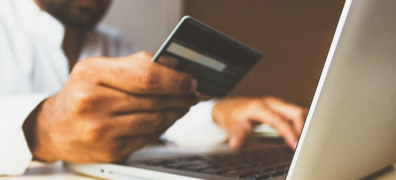 a man holding a creditcard