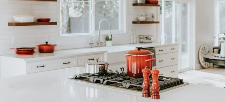 Complete packing and moving dishes before moving your kitchen