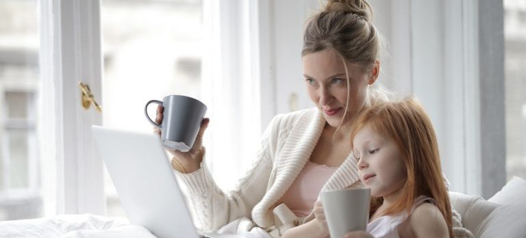 A mother looking for the best school for her daughter because she knows how important it is to choose the perfect elementary school for your kids after the move and her daughter keeping her company.