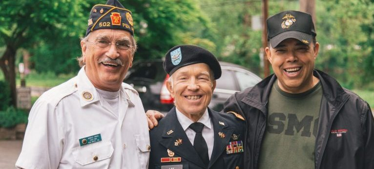 Three veterans smiling.