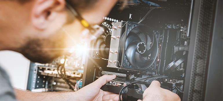 a man dismantling a PC