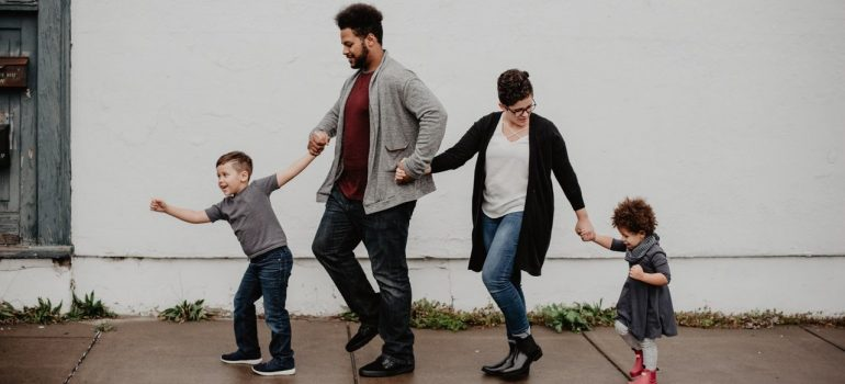 a family walking down the pavement as a way of helping kids settle into a new home in Verona