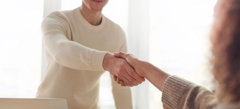 Man and a woman handshaking.