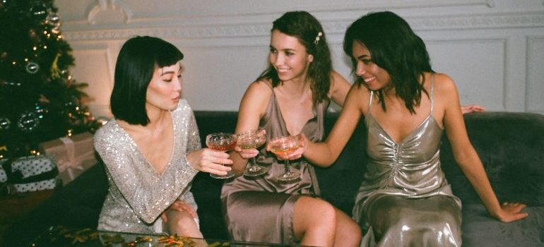 Three women networking at a cocktail party.