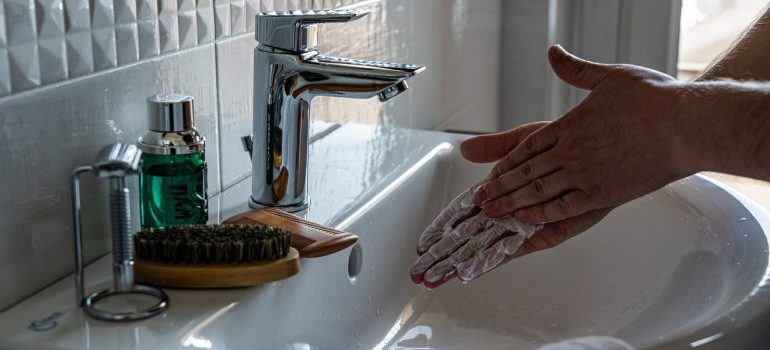 A person washing hands.