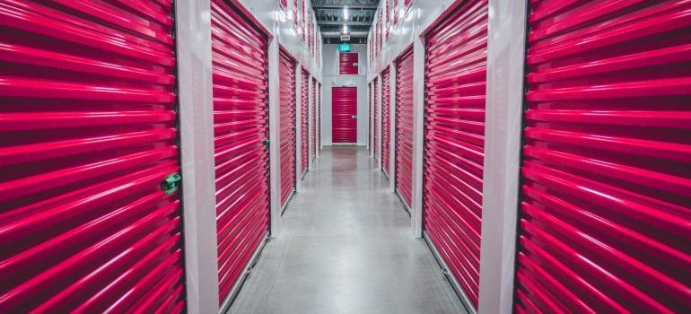 Storage units with pink sliding doors.