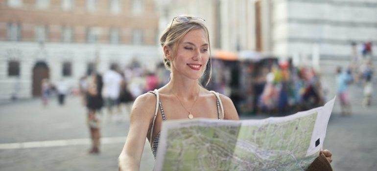 woman looking at the map and thinking which Bergen County neighborhoods are best for startups