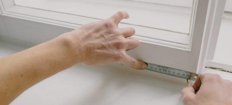 Person measuring furniture