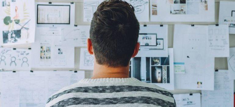 A man looking at a plan.
