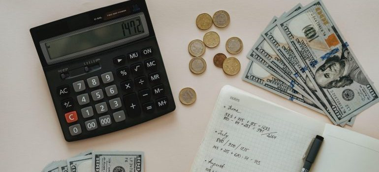 notebook, calculator and money on the table